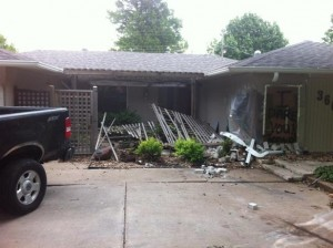 Police suspect alcohol was involved in this car crash-into-home incident three days ago.